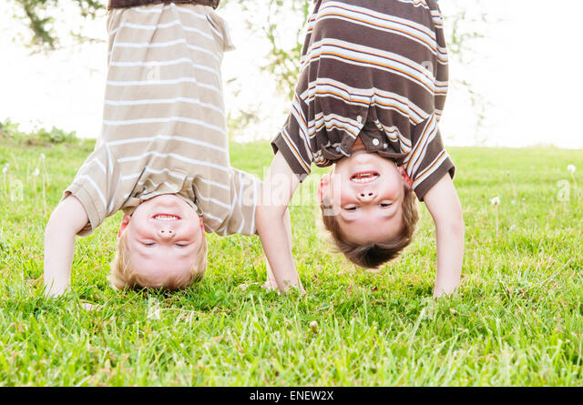 two boys upside down - Stock Image