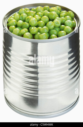 Peas in can against white background, close up - Stock Image