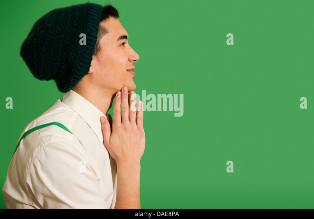 Portrait of young man wearing knit hat - Stock Image