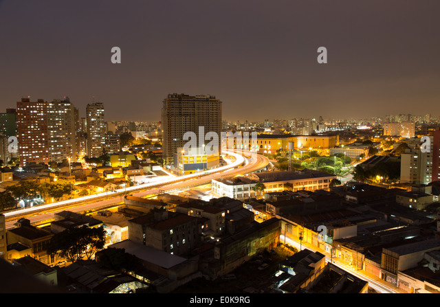 Aerial view of the city at night, from Liberdade District, Sao Paulo, Brazil. Long exposure shot. - Stock Image