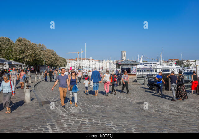 Holidaymakers walking around the Old Port, La Rochelle, France. - Stock Image