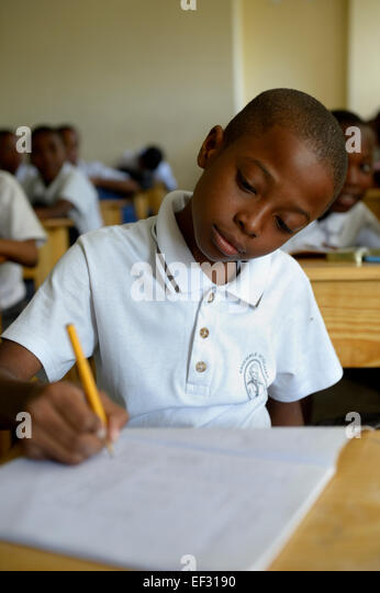 Schoolboy, 10 years, class at the Basile Moreau Primary School, Carrefour, Port-au-Prince, Ouest Department, Haiti - Stock Image
