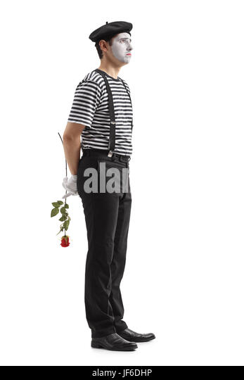 Full length profile shot of a sad mime with a rose waiting in line isolated on white background - Stock Image
