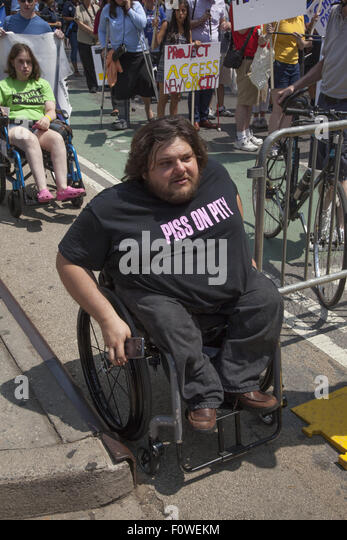 People with various disabilities mark the 25th anniv. of the Americans With Disabilities Act with a parade in NYC. - Stock Image