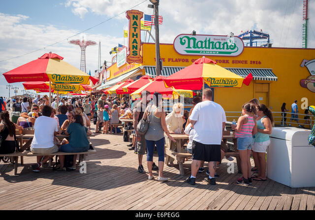 Visitors to Coney Island in New York on Sunday, August 24, 2014 stop at the Nathan's Famous restaurant branch - Stock-Bilder
