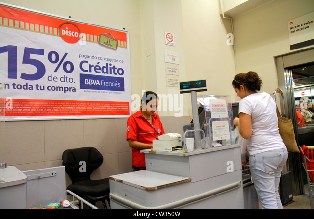 Buenos Aires Argentina Avenida Callao Disco Supermarket grocery store supermarket chain shopping checkout counter - Stock Image