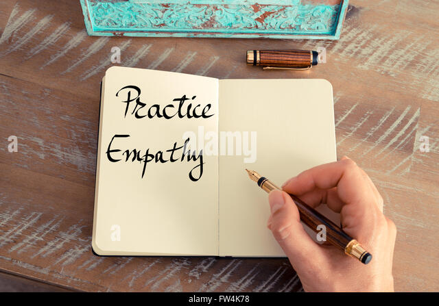 Retro effect and toned image of a woman hand writing a note with a fountain pen on a notebook. Handwritten text - Stock Image