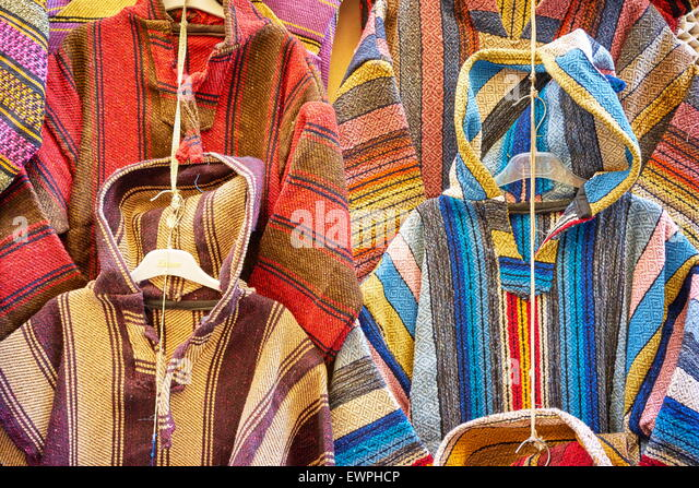 Clothing shop. Wool djellabas, Berber Moroccan traditional dress. Morocco - Stock Image