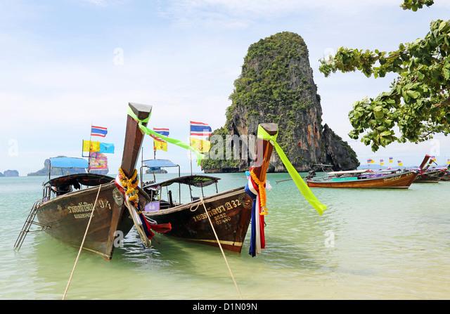 Traditional Thai long tail boats at Phranang Cave Beach, Railay Beach, Krabi, Phuket, Thailand - Stock Image