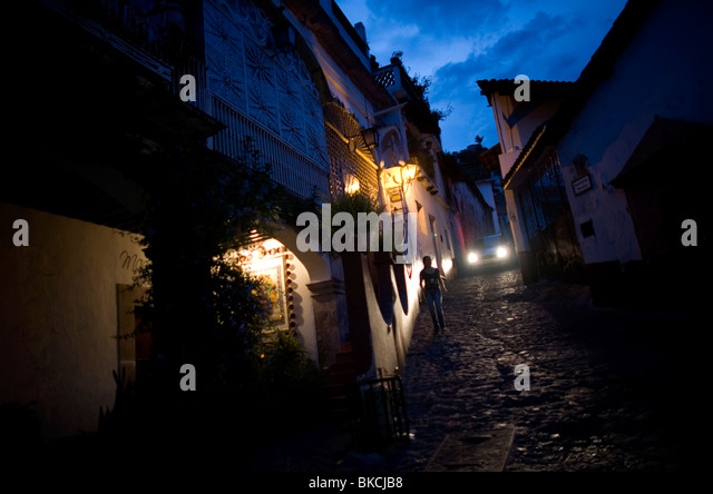 A woman walks in a street of Taxco de Alarcon in Guerrero State, Mexico, August 20, 2007. Photo/Chico Sanchez - Stock Image