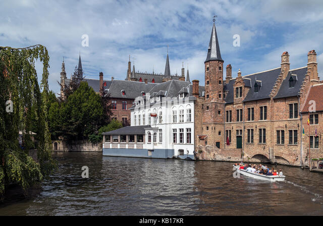 Rozenhoedkaai in the city of Bruges in Belgium, with the Belfry in the background. The historic city center is a - Stock Image