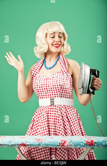 Retro Housewife with her new iron - Stock-Bilder
