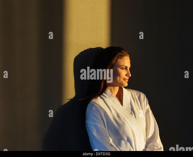 Pensive woman in bathrobe - Stock-Bilder
