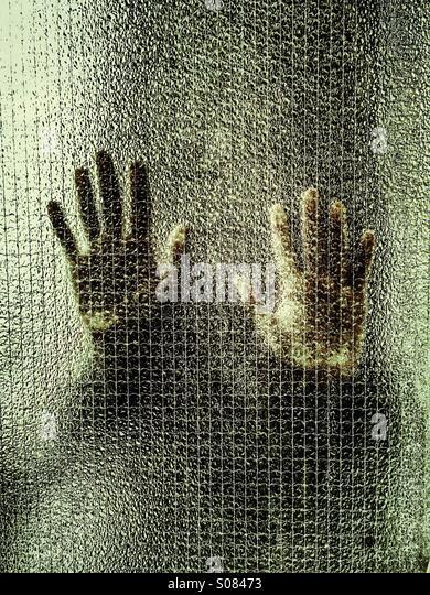 Man behind glass - Stock Image
