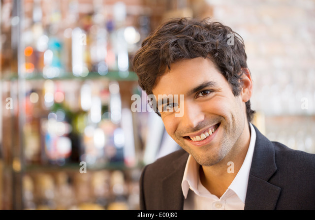 Male smiling cheerful coffee bar looking camera - Stock Image