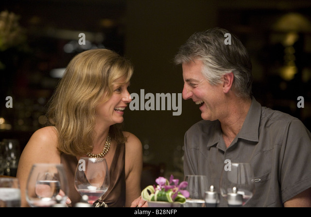 Middle aged couple enjoying a fine dinning experience Whistler Village British Columbia Canada - Stock Image
