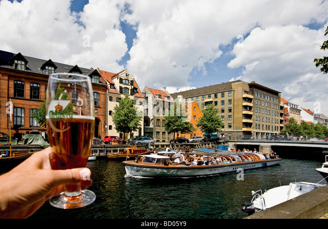 Cheers to the sightseeing boat in Christianshavn canal, Copenhagen, Denmark, Europe - Stock Image