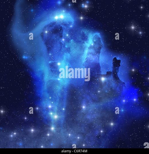 The brilliant blues of this star making nebula shine throughout the cosmos. - Stock Image