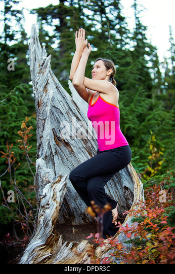 Woman doing yoga, Bellingham, Washington, USA - Stock Image