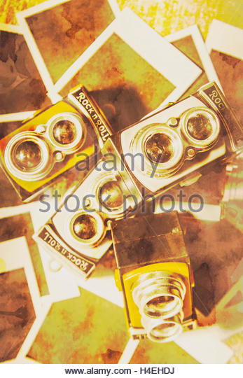 Old photo still-life with a outdated collection of past Twin-Lens Reflex cameras overlayed on faded texture. Yesterdays - Stock Image