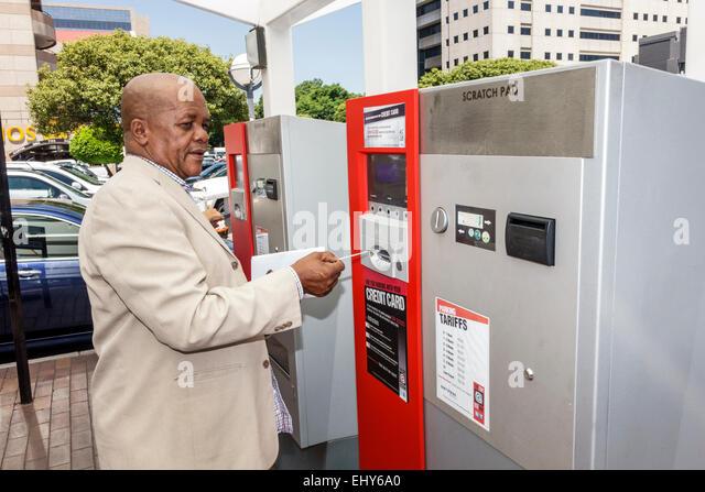 South Africa African Johannesburg Black man parking vending machine using - Stock Image