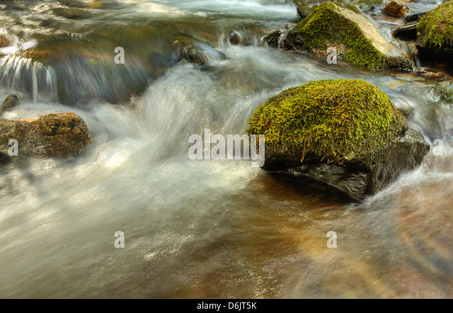 dappled sunlight and shadows on the swift waters of the River Ashburn in Dartmoor - Stock Image