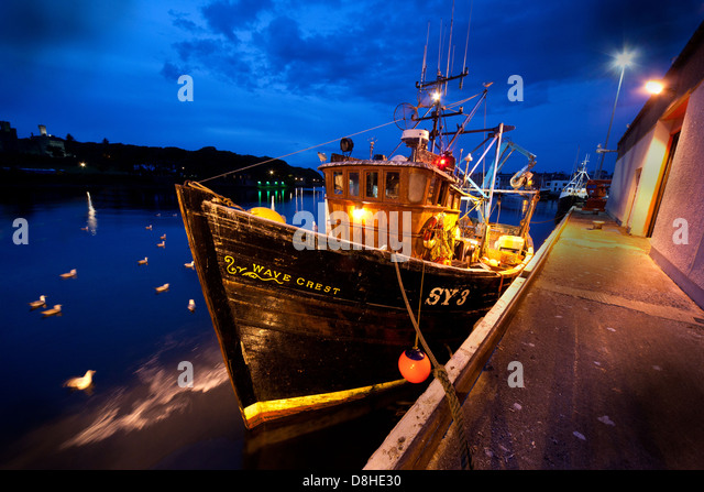 Wave Crest Trawler docked at Stornoway Fishing Port & Harbour at dusk - Stock Image