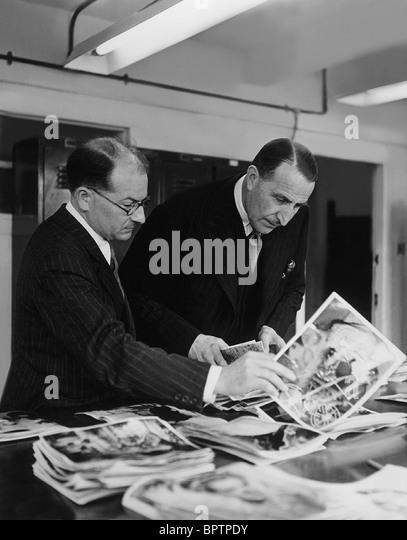 J. ARTHUR RANK & E. WOODS DIRECTOR OF RANK FILMS (1955) - Stock Image