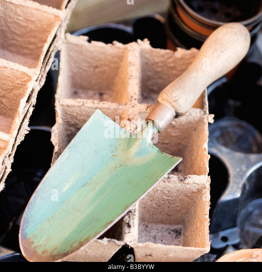 A trowel and plant pots - Stock Image