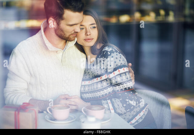 Romantic couple having rest in cafe - Stock Image