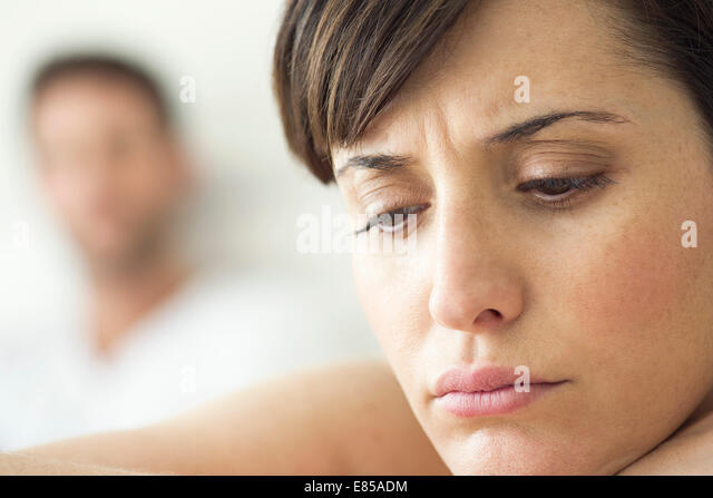Woman contemplative and withdrawn after disagreement with husband - Stock Image