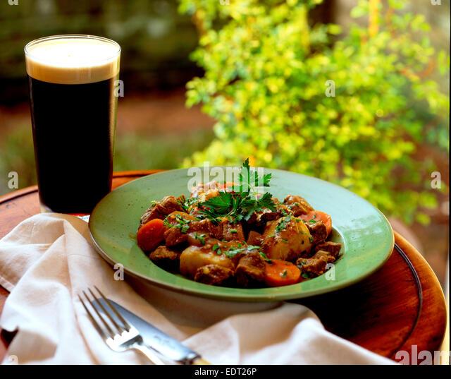 Irish stew and Guinness - Stock Image