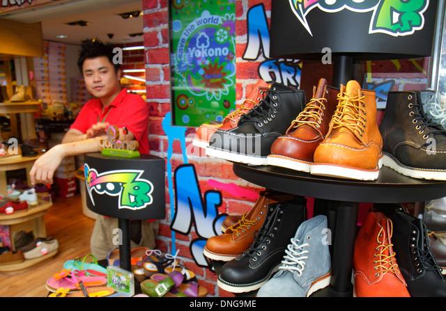 Hong Kong China Kowloon Mong Kok Fa Yuen Street Sneaker Street shopping fashion athletic shoe store sale display - Stock Image