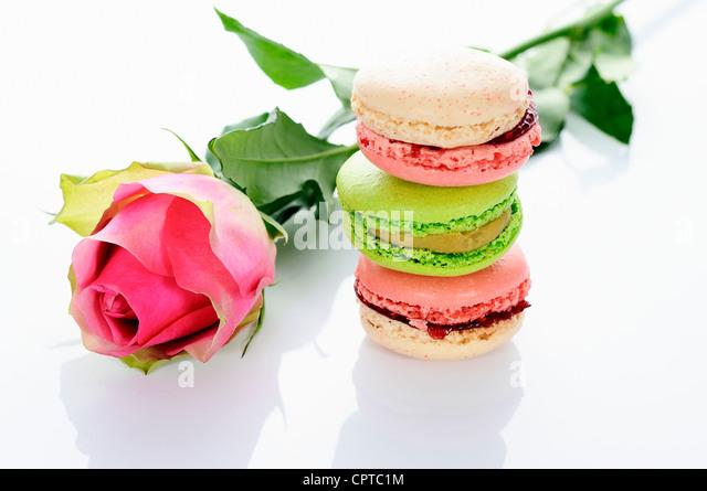 beautiful rose and assortment of macarons - Stock Image