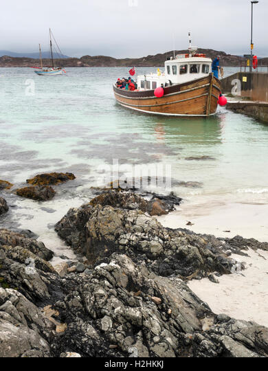 Boat Arriving at the Slipway on Iona Argyll and Bute Scotland - Stock Image