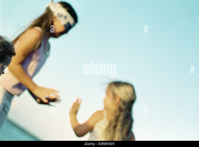 Children playing blind man's buff, blurred - Stock Image