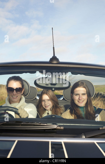 Family driving in rural landscape - Stock Image