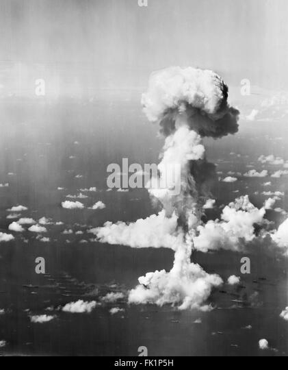Nuclear Explosion. Ships beneath the mushroom cloud from Operation Crossroads nuclear weapons test at Bikini Atoll, - Stock Image