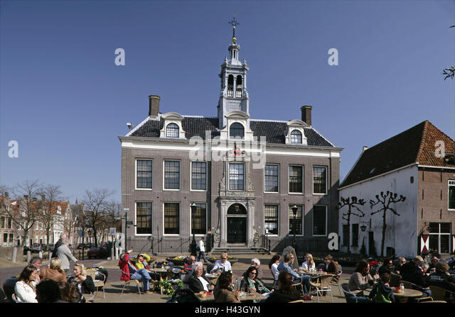The Netherlands, Edam, city hall, street cafe, person, - Stock Image