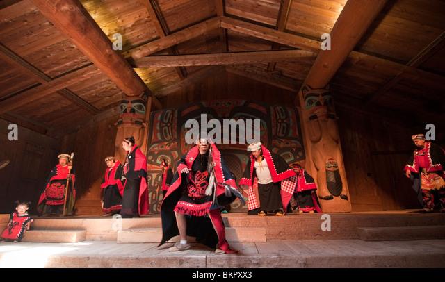 Tlingit native dancers at the Saxman Village clan house, Ketchikan, Alaska - Stock Image