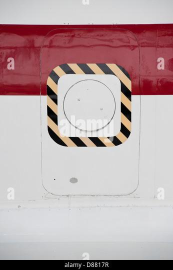 emergency door in airplane fuselage - Stock Image
