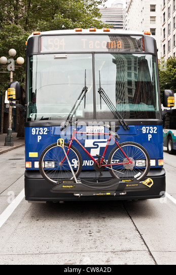 Seattle Tacoma intercity bus with bicycle rack on front & historic buildings reflected in windshield Seattle - Stock-Bilder