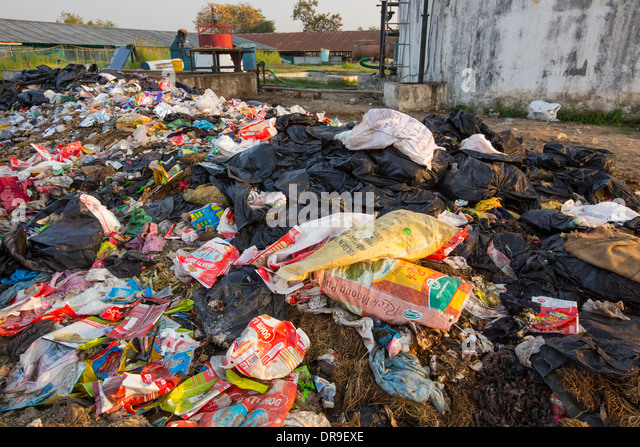 biogas plant, that is fed with food waste and manure and fuels the kitchens at The Muni Seva Ashram in Goraj, India - Stock Image