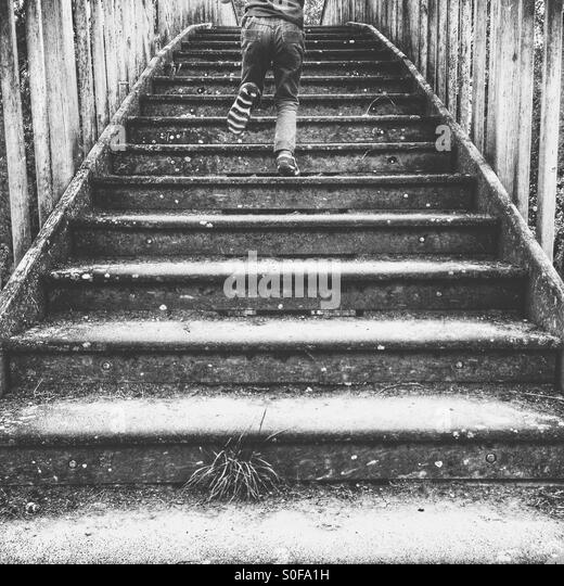 Child running up steps - Stock-Bilder
