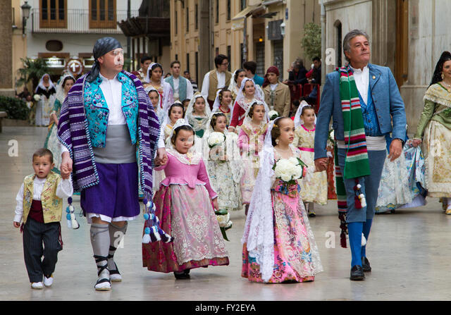 Flower offering procession in honour of the Lady of the Forsaken during Fallas Festival Valencia Spain - Stock Image