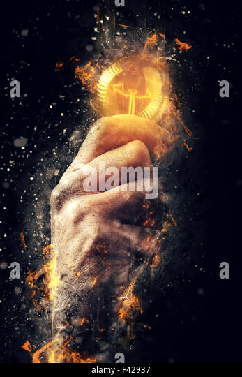 Power of creative energy and new ideas and understandings, hand with light bulb as metaphor of innovation and creativity, - Stock Image