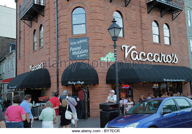 Baltimore Maryland Little Italy ethnic neighborhood business Vaccaro's bakery restaurant entrance line out the - Stock Image