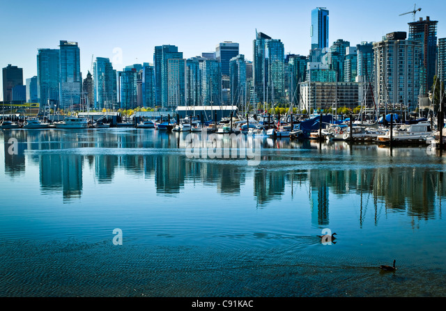 Downtown skyline of Vancouver as seen from Stanley Park, B.C., Canada, Spring - Stock Image