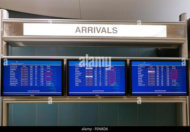 Arriving flight Information display board at Ronald Reagan Washington National Airport - USA - Stock Image