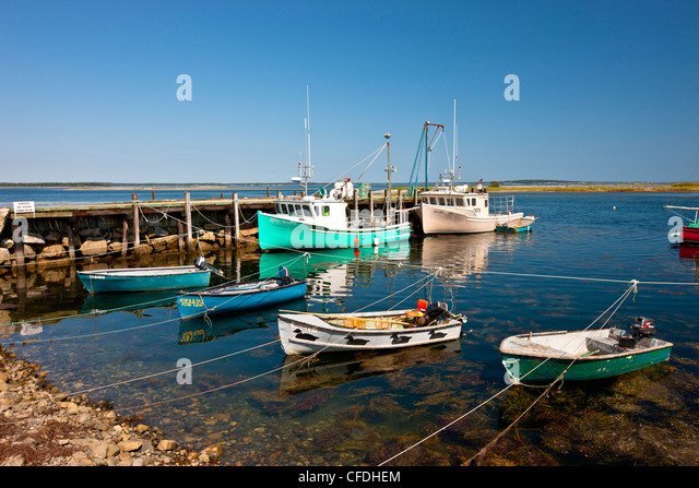Fishing boats tied up at Old Port Mouton wharf, Nova Scotia, Canada - Stock Image